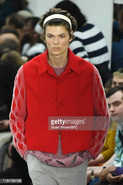A model walks the runway at the Stefan Cooke show during London Fashion Week Men's June 2019 at the BFC Show Space on June 09 2019 in London England