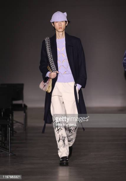 A model walks the runway at the Stefan Cooke show during London Fashion Week Men's January 2020 at the BFC Show Space on January 05 2020 in London...