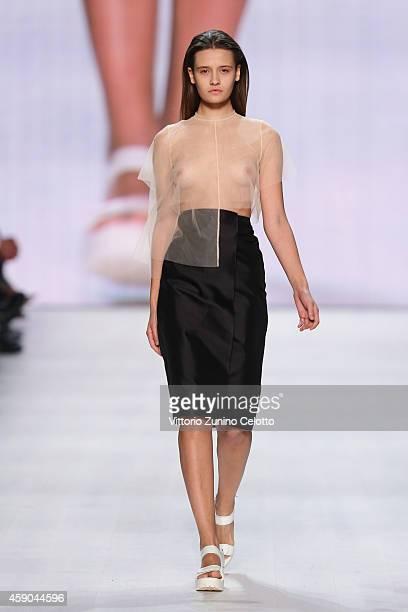 A model walks the runway at the Stefanie Biggel show during the MercedesBenz Fashion Days Zurich 2014 on November 15 2014 in Zurich Switzerland