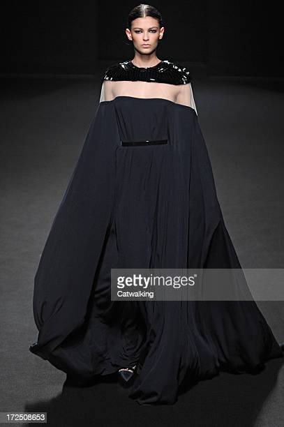 Model walks the runway at the Stephane Rolland Autumn Winter 2013 fashion show during Paris Haute Couture Fashion Week on July 2, 2013 in Paris,...