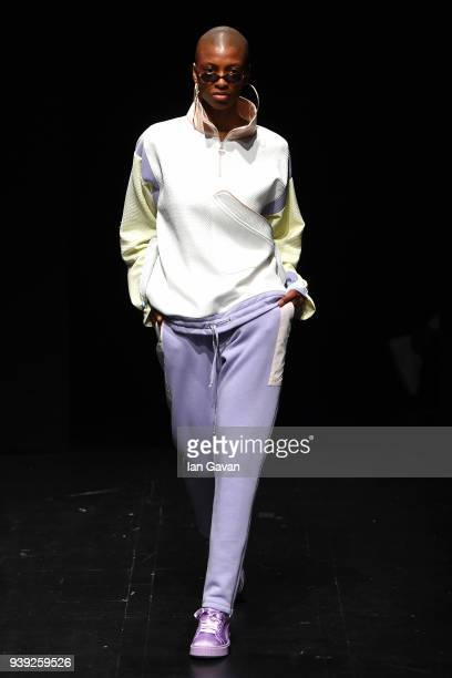 A model walks the runway at the 'Still Taste the Past' show of Sebnem Gunay as part of the New GEN by IMA show during Mercedes Benz Fashion Week...