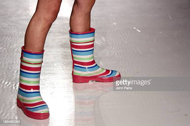 A model walks the runway at the Stride Rite Children's Group Fashion Showcase at petitePARADE on October 6 2013 at Industria Superstudios in New York...