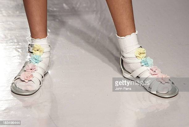 A model walks the runway at the Stride Rite show during the petiteParade NY Kids Fashion Week in Collaboration with VOGUE Bambini on October 6 2013...