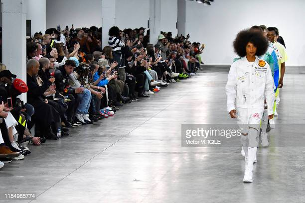 A model walks the runway at the Studio ALCH Ready to Wear Spring/Summer 2020 fashion show during London Fashion Week Men's June 2019 on June 09 2019...