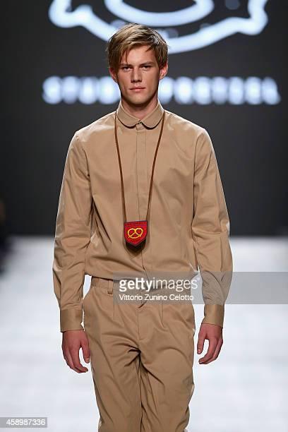 A model walks the runway at the Studiopretzel show during the MercedesBenz Fashion Days Zurich 2014 on November 14 2014 in Zurich Switzerland
