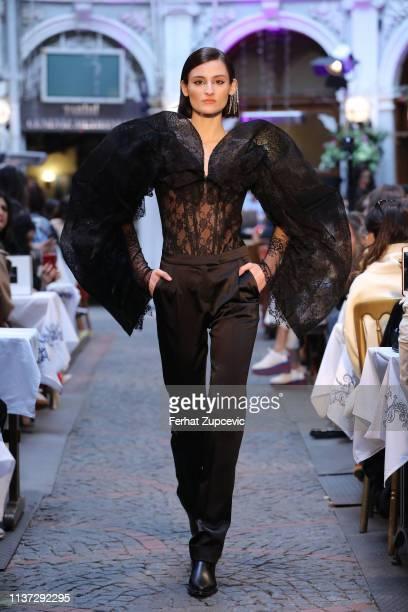 A model walks the runway at the Sudi Etuz show during MercedesBenz Istanbul Fashion Week on March 21 2019 in Istanbul Turkey