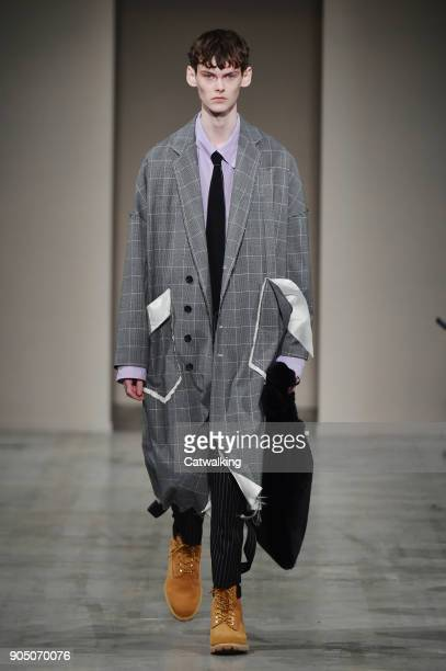 A model walks the runway at the Sulvam Autumn Winter 2018 fashion show during Milan Menswear Fashion Week on January 14 2018 in Milan Italy