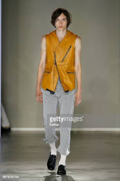 A model walks the runway at the Sulvam show during Milan Men's Fashion Week Spring/Summer 2018 on June 18 2017 in Milan Italy