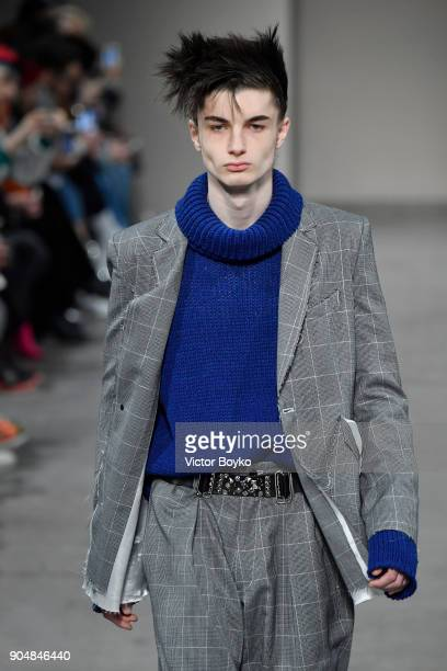 A model walks the runway at the Sulvam show during Milan Men's Fashion Week Fall/Winter 2018/19 on January 14 2018 in Milan Italy