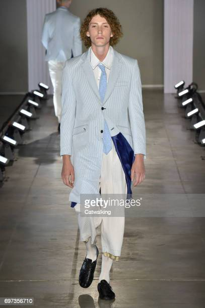 A model walks the runway at the Sulvam Spring Summer 2018 fashion show during Milan Menswear Fashion Week on June 18 2017 in Milan Italy