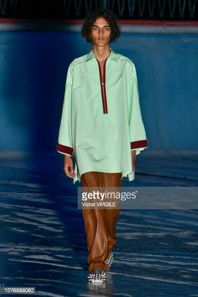 Model walks the runway at the Sunnei Ready to Wear Spring/Summer 2021 fashion show during the Milan Women's Fashion Week on September 24, 2020 in...