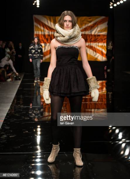A model walks the runway at the Superdry show during The London Collections Men Autumn/Winter 2014 at the Old Sorting Office on January 7 2014 in...