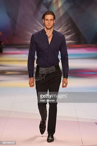 A model walks the runway at the Swarovski show at MercedesBenz Fashion Week Australia 2014 at on April 9 2014 in Sydney Australia