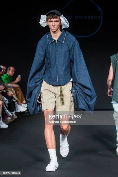 Model walks the runway at the Swedish Fashion Talents show during Stockholm Runway SS19 at Grand Hotel on August 29, 2018 in Stockholm, Sweden.