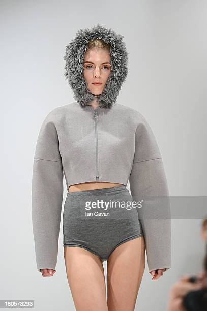 A model walks the runway at the Swedish School Of Textiles show at the Fashion Scout venue during London Fashion Week SS14 at Freemasons Hall on...