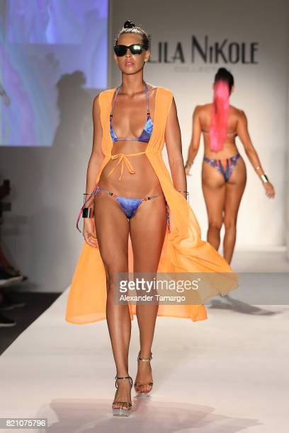 A model walks the runway at the SWIMMIAMI Lila Nikole 2018 Collection fashion show at the SWIMMIAMI tent on July 22 2017 in Miami Beach Florida