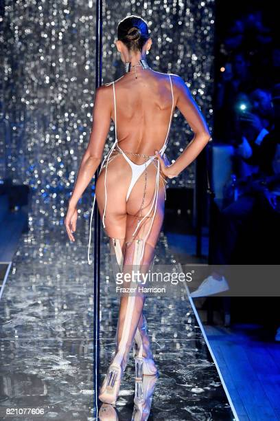 A model walks the runway at the SWIMMIAMI Minimale Animale 2018 Collection fashion show at Ora Nightclub on July 22 2017 in Miami Beach Florida