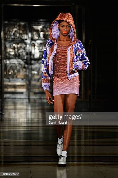A model walks the runway at the Tabernacle Twins show during at the Fashion Scout venue during London Fashion Week SS14 at Freemasons Hall on...