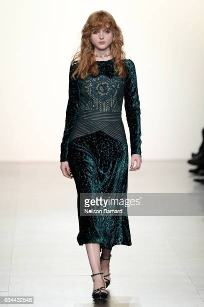 A model walks the runway at the Tadashi Shoji fashion show during New York Fashion Week The Shows at Gallery 1 Skylight Clarkson Sq on February 9...