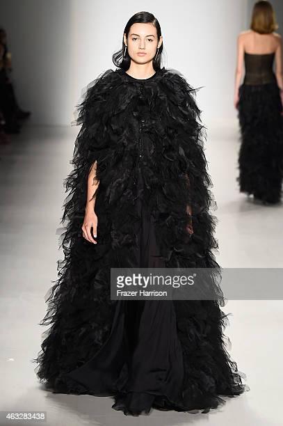 A model walks the runway at the Tadashi Shoji fashion show during MercedesBenz Fashion Week Fall 2015 at The Salon at Lincoln Center on February 12...