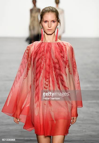 A model walks the runway at the Tadashi Shoji fashion show durng New York Fashion Week The Shows at The Arc Skylight at Moynihan Station on September...