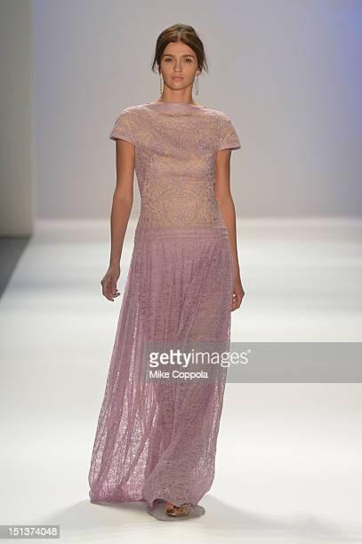 A model walks the runway at the Tadashi Shoji Spring 2013 fashion show during MercedesBenz Fashion Week on on September 6 2012 in New York City