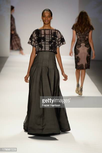 A model walks the runway at the Tadashi Shoji Spring 2014 fashion show during MercedesBenz Fashion Week at The Stage at Lincoln Center on September 5...