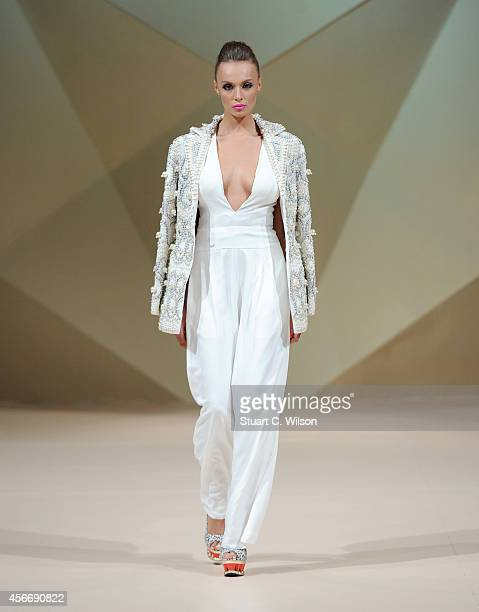 Model walks the runway at the Tahir Sultan presented by W Retreat & Spa Maldives show during Fashion Forward at Madinat Jumeirah on October 5, 2014...