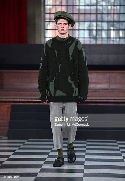 A model walks the runway at the TAK LEE LCF MA17 show during London Fashion Week Men's January 2017 collections at St John's Smith Square on January...