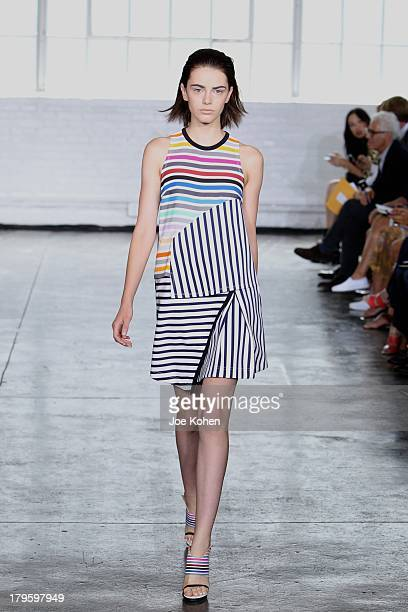 Model walks the runway at the Tanya Taylor fashion show during Mercedes-Benz Fashion Week Spring 2014 at Industria Studios on September 5, 2013 in...