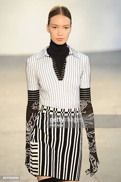 A model walks the runway at the Tanya Taylor show during MercedesBenz Fashion Week Fall 2015 at Industria Studios on February 13 2015 in New York City