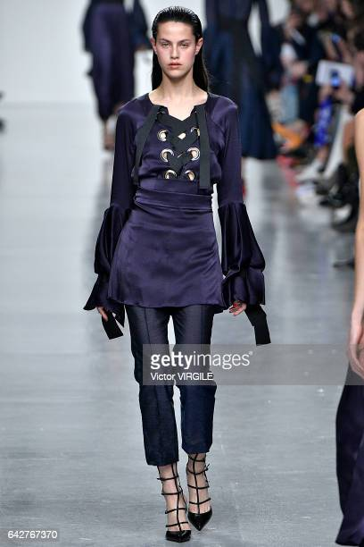 Model walks the runway at the Teatum Jones Ready to Wear Fall Winter 2017-2018 fashion show during the London Fashion Week February 2017 collections...