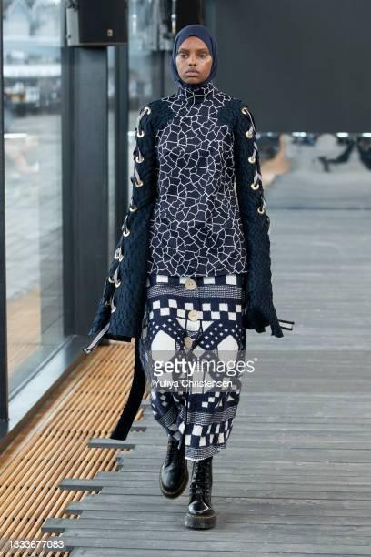 Model walks the runway at the Teatum Jones show during the Copenhagen Fashion Week Spring/Summer 2022 on August 11, 2021 in Copenhagen, Denmark.
