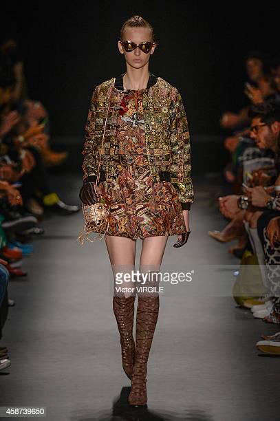 A model walks the runway at the Teca por Helo Rocha fashion show during Sao Paulo Fashion Week Winter 2015 at Parque Candido Portinari on November 6...