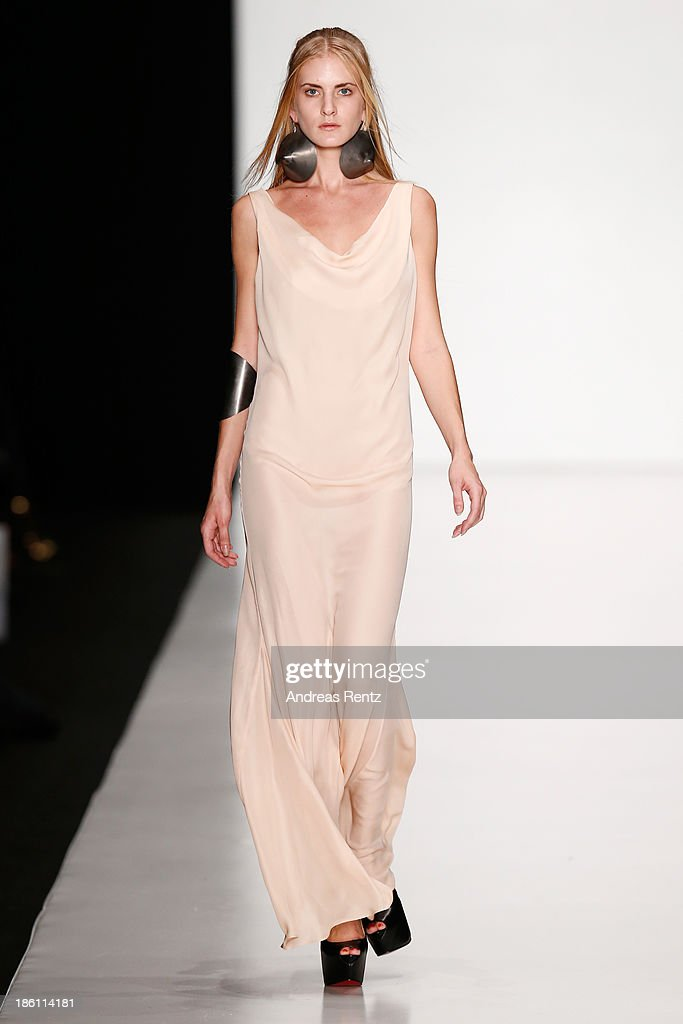 A model walks the runway at the Tel Aviv Fashion Week Collections show during Mercedes-Benz Fashion Week Russia S/S 2014 on October 28, 2013 in Moscow, Russia.