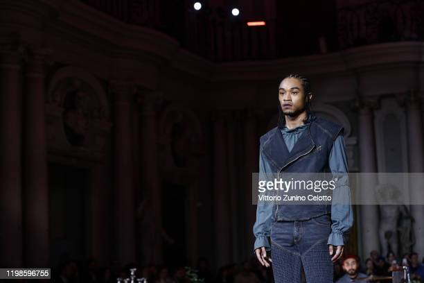 A model walks the runway at the Telfar fashion show during Pitti Immagine Uomo 97 at Fortezza Da Basso on January 09 2020 in Florence Italy