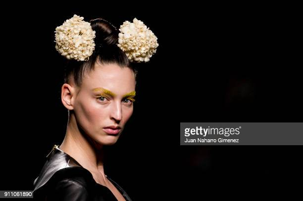 A model walks the runway at the Teresa Helbig show during the MercedesBenz Fashion Week Madrid Autumn/Winter 201819 at Ifema on January 27 2018 in...