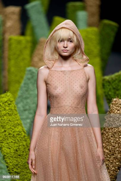 A model walks the runway at the Teresa Helbig show during the MercedesBenz Fashion Week Madrid Spring/Summer 2019 at IFEMA on July 8 2018 in Madrid...