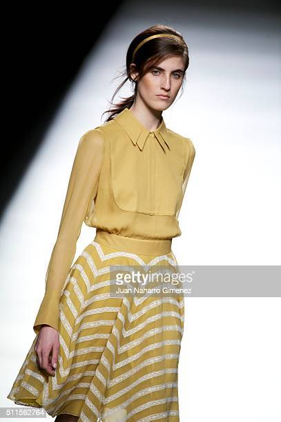 A model walks the runway at the Teresa Helbig show during the MercedesBenz Madrid Fashion Week Autumn/Winter 2016/2017 at Ifema on February 21 2016...