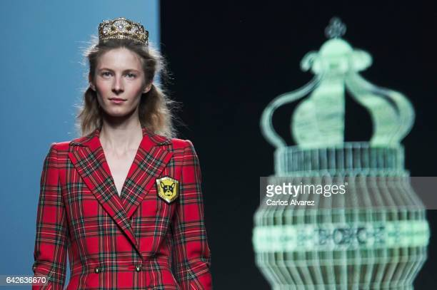 A model walks the runway at the Teresa Helbig show during the MercedesBenz Madrid Fashion Week Autumn/Winter 2017/2018 at Ifema on February 18 2017...