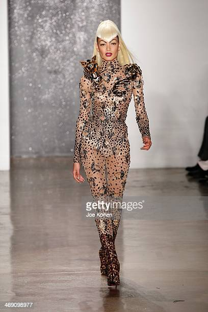 A model walks the runway at the The Blonds fashion show during Fall 2014 MADE Fashion Week Fall 2014 at Milk Studios on February 12 2014 in New York...