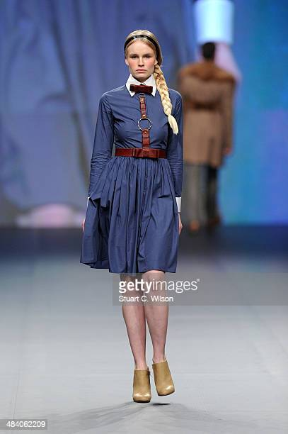 A model walks the runway at the The Emperor 1688 show during Fashion Forward at Madinat Jumeirah on April 11 2014 in Dubai United Arab Emirates