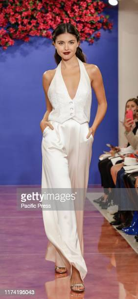 Model walks the runway at the Theia Fall 2020 collection during New York Bridal Week at the Theia Showroom, Manhattan.