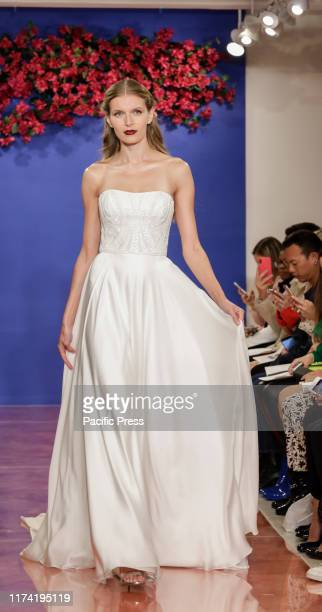 A model walks the runway at the Theia Fall 2020 collection during New York Bridal Week at the Theia Showroom Manhattan
