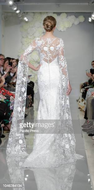 A model walks the runway at the Theia runway show during New York Bridal Week at the Theia Showroom Manhattan