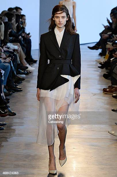 Model walks the runway at the Theory Autumn Winter 2014 fashion show during New York Fashion Week on February 10, 2014 in New York, United States.
