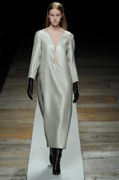 3875b42fc3 A model walks the runway at the Theyskens' Theory Autumn Winter 2013  fashion show during