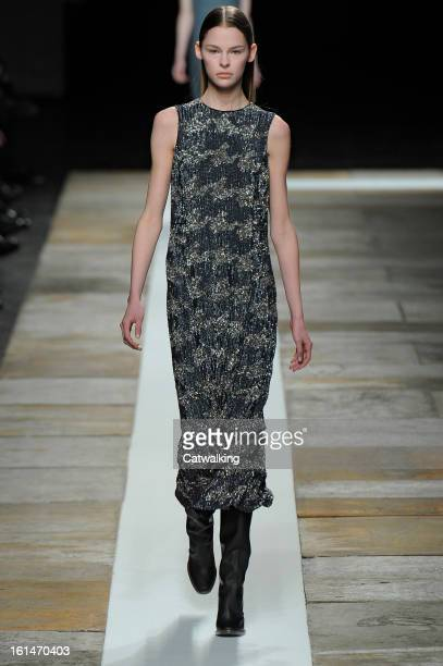 Model walks the runway at the Theyskens' Theory Autumn Winter 2013 fashion show during New York Fashion Week on February 11, 2013 in New York, United...