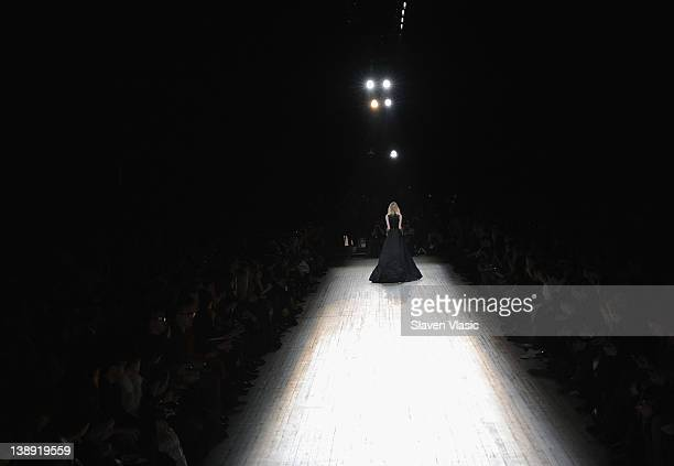 Model walks the runway at the Theysken's Theory fall 2012 fashion show during Mercedes-Benz Fashion Week at the Park Avenue Armory on February 13,...