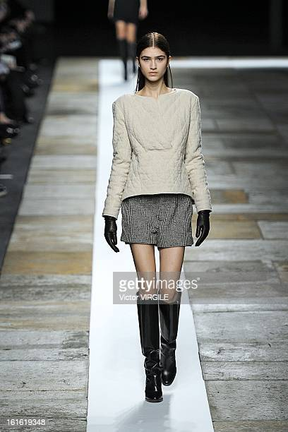 Model walks the runway at the Theyskens' Theory Ready to Wear Fall/Winter 2013-2014 fashion show during Mercedes-Benz Fashion Week at Skylight at...